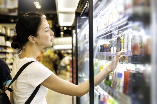 woman looking at product at grocery store